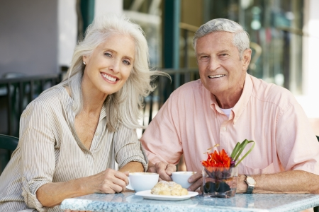retirement: Senior Couple Enjoying Snack At Outdoor Caf� Stock Photo