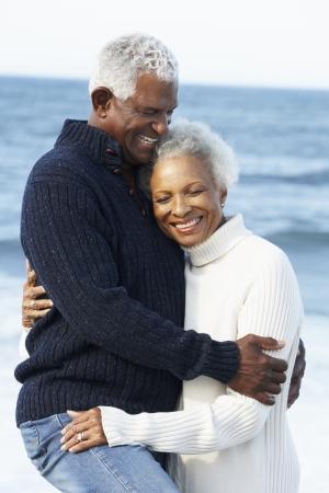 Romantic Senior Couple Hugging On Beach Stock Photo - 18736690