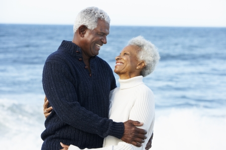 couples hug: Romantic Senior Couple Hugging On Beach Stock Photo