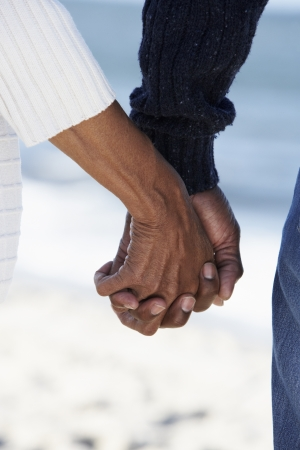 loving hands: Close Up Of Senior Couple Holding Hands On Beach