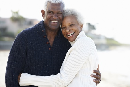 american seniors: Romantic Senior Couple Hugging On Beach Stock Photo