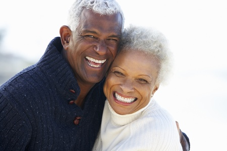 a couple: Romantic Senior Couple Hugging On Beach Stock Photo