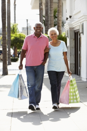 Senior Couple Carrying Shopping Bags Stock Photo - 18736392