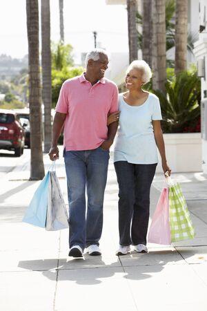 Senior Couple Carrying Shopping Bags photo