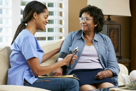 seniors homes: Nurse Visiting Senior Female Patient At Home