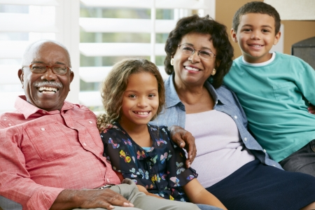 70 year old man: Portrait Of Grandparents With Grandchildren Stock Photo