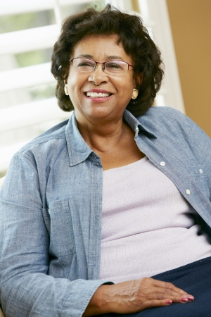 senior home: Portrait Of Happy Senior Woman At Home