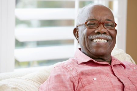 senior african: Portrait Of Happy Senior Man At Home