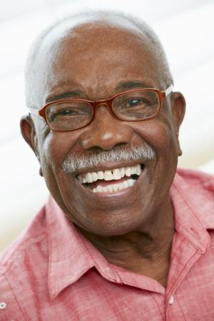 black head and moustache: Portrait Of Happy Senior Man At Home
