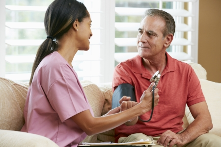 Nurse Visiting Senior Male Patient At Home Stock Photo - 18735892