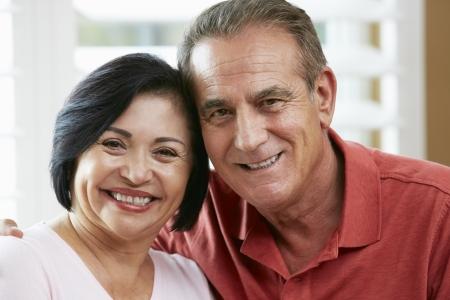 hispanic couple: Portrait Of Happy Senior Couple At Home