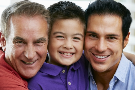 sons and grandsons: Male Members Of Multi Generation Family At Home