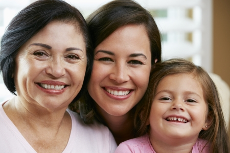 Female Members Of Multi Generation Family At Home Stock Photo