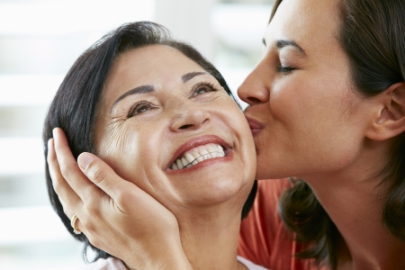 30s adult: Portrait Of Adult Daughter Kissing Mother