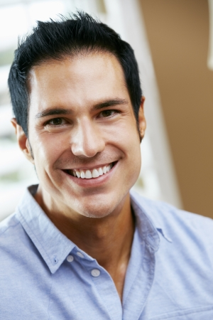 male age 40's: Portrait Of Smiling Man At Home