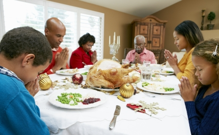 prayer: Multi Generation Family Celebrating With Christmas Meal