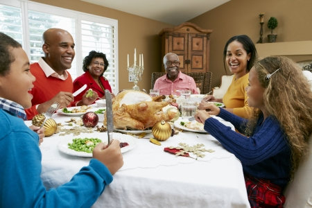 5 10 year old girl: Multi Generation Family Celebrating With Christmas Meal