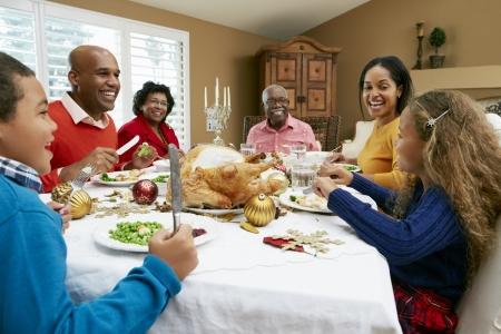 celebrating: Multi Generation Family Celebrating With Christmas Meal