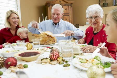 18 to 30s: Multi Generation Family Celebrating With Christmas Meal