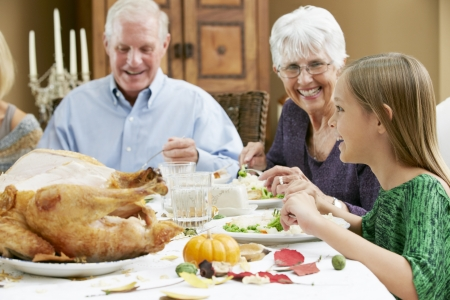 old people eating: Granddaughter Celebrating Thanksgiving With Grandparents