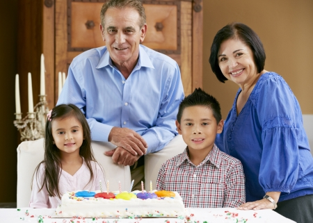 Grandparents Celebrating Children's Birthday photo