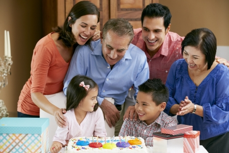 Multi Generation Family Celebrating Children's Birthday Stock Photo - 18735724