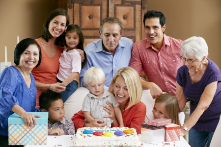 Multi Generation Family Celebrating Childrens Birthday photo