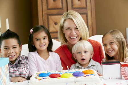 Mother Celebrating Child's Birthday With Friends Stock Photo - 18735721
