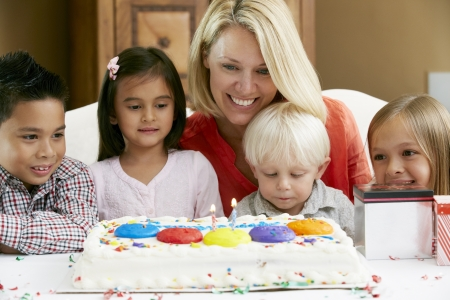 Mother Celebrating Child's Birthday With Friends Stock Photo - 18735753