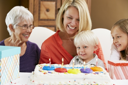 Family Celebrating Childrens Birthday With Grandmother photo