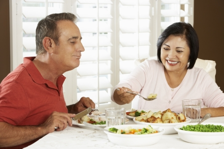 Senior Couple Enjoying Meal At Home photo