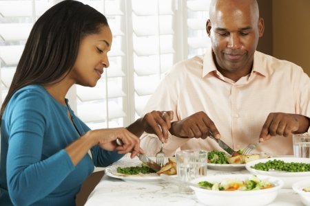 mealtime: Couple Enjoying Meal At Home