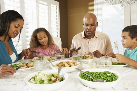 5 10 year old girl: Family Enjoying Meal At Home Stock Photo