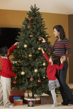 Mother And Children Decorating Christmas Tree photo