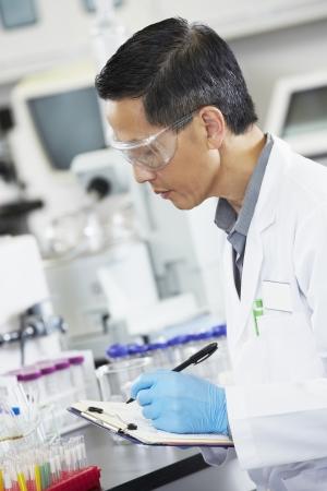 scientist man: Male Scientist Working In Laboratory Stock Photo