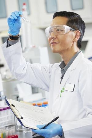 biologist: Male Scientist Working In Laboratory Stock Photo