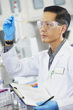 laboratory glass: Male Scientist Working In Laboratory Stock Photo