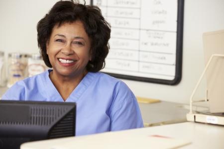Nurse Using Computer At Nurses Station photo