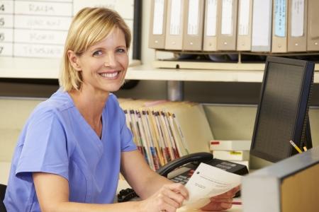 nurses station: Portrait Of Nurse Working At Nurses Station