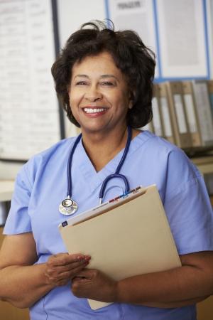 nurses station: Female Nurse At Nurses Station