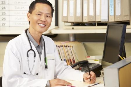 nurses station: Doctor Working At Nurses Station