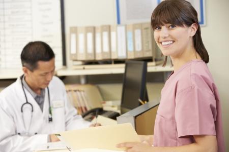 nurse station: Nurse With Doctor Working At Nurses Station