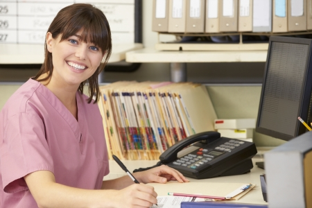 nurse computer: Nurse Working At Nurses Station Stock Photo