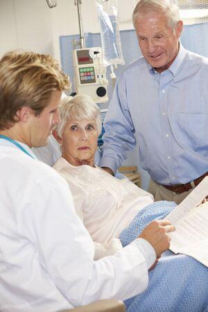 geriatric: Doctor Talking To Senior Couple On Ward