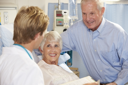 Doctor Talking To Senior Couple On Ward photo