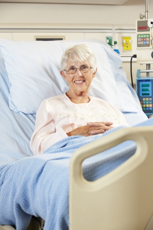 Portrait Of Senior Female Patient Relaxing In Hospital Bed photo