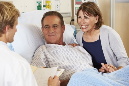 Doctor Talking To Couple On Ward photo