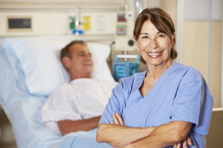 Portrait Of Nurse With Patient In Background photo