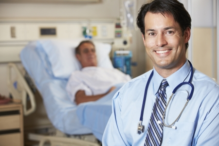 doctor: Portrait Of Doctor With Patient In Background Stock Photo