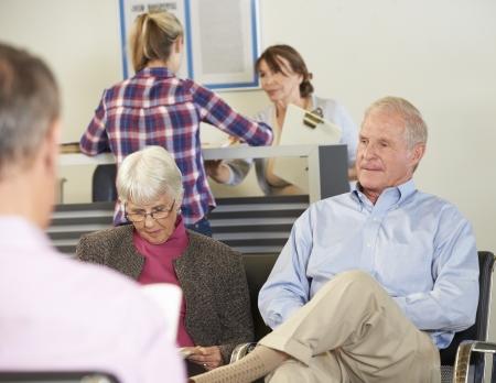 waiting man: Patients In Doctors Waiting Room